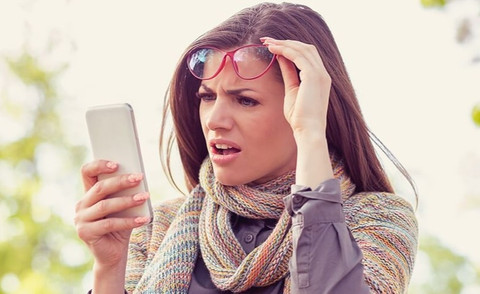 women surpricingly looking at mobile phone